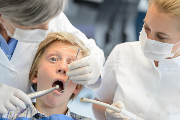 Stock photo: Dentist assistant check teeth teenager boy patient