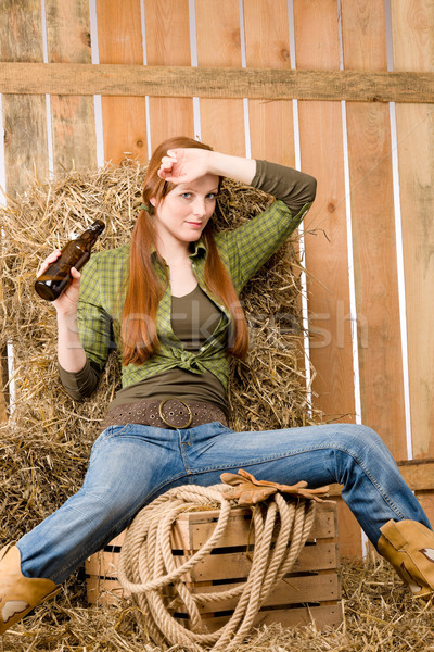 Provocative young cowgirl drink beer in barn Stock photo © CandyboxPhoto