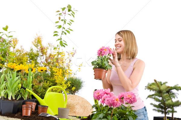 Grădinărit fericit femeie ghiveci de flori Imagine de stoc © CandyboxPhoto