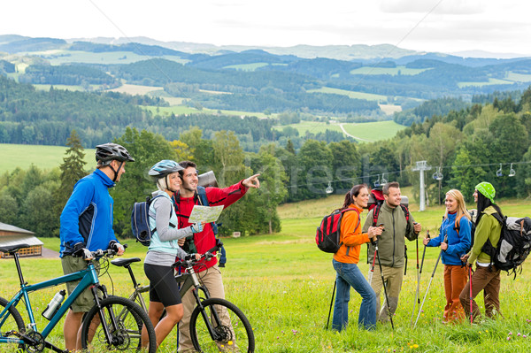 Hikers helping cyclists following track nature landscape Stock photo © CandyboxPhoto
