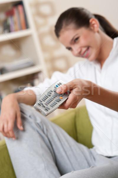 Studenten glimlachend vrouwelijke tiener afstandsbediening moderne Stockfoto © CandyboxPhoto
