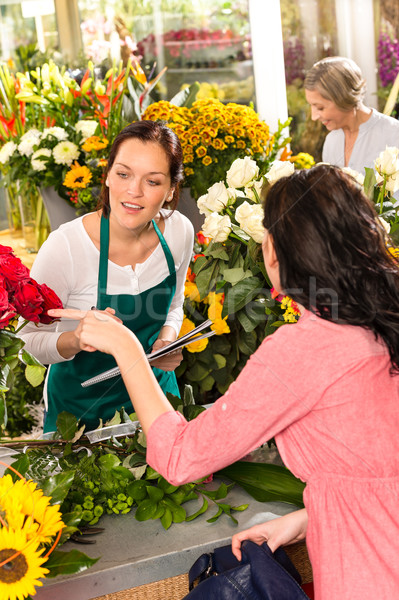 Young florist ordering roses woman customer flower  Stock photo © CandyboxPhoto