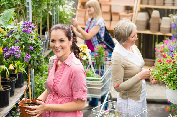 Woman hold potted plant at garden shop Stock photo © CandyboxPhoto