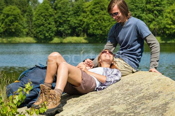 Trekking couple resting at lakeside Stock photo © CandyboxPhoto