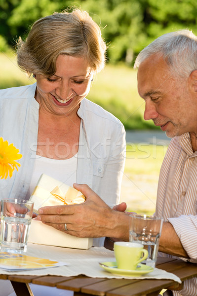 Elderly married couple opening present  Stock photo © CandyboxPhoto
