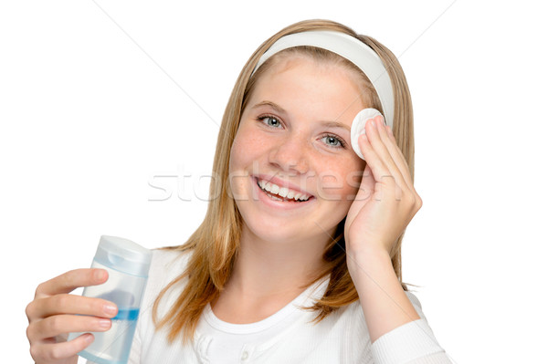 Young cheerful girl removing make-up cleansing pad Stock photo © CandyboxPhoto
