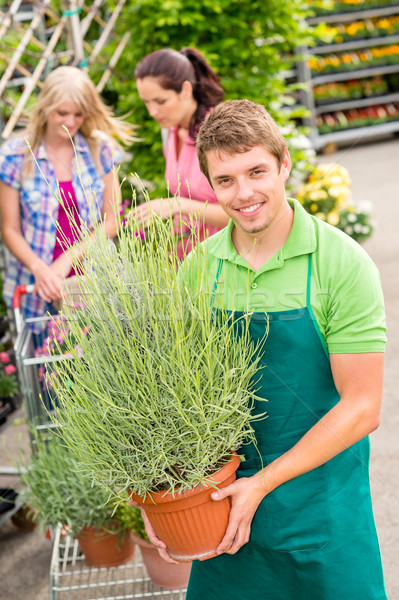 Garden centre worker hold potted plant Stock photo © CandyboxPhoto