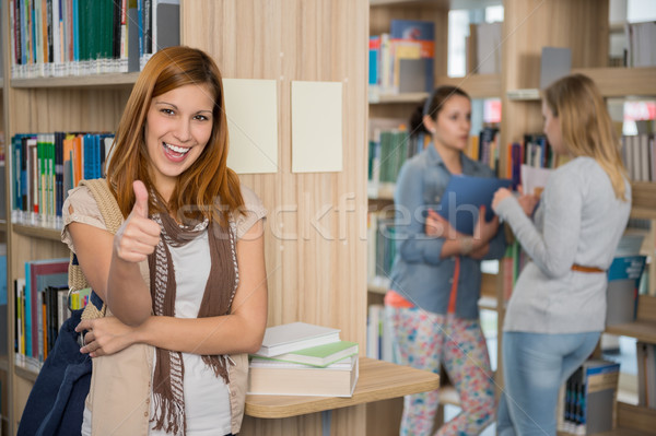 Student showing thumb up in library Stock photo © CandyboxPhoto