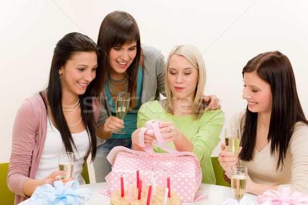 Birthday party - woman unwrap present, celebrating  Stock photo © CandyboxPhoto