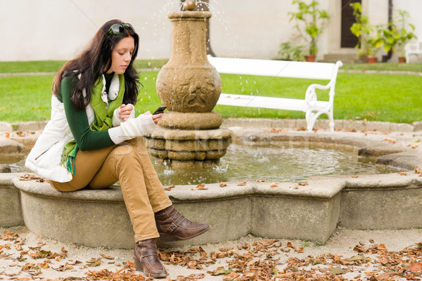 Autumn park fountain young woman hold phone Stock photo © CandyboxPhoto