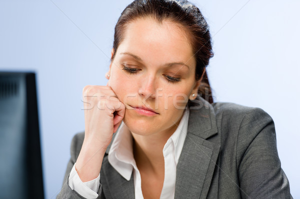Stock photo: Bored female office employee at work