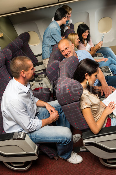 Leisure travel people enjoy flight airplane cabin Stock photo © CandyboxPhoto