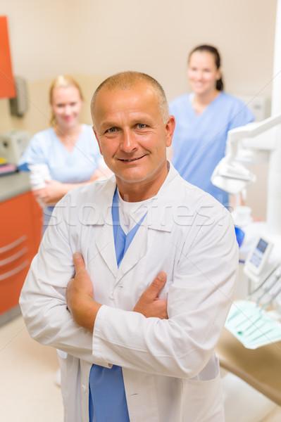 Profissional dentista equipe cirurgia dentária retrato maduro Foto stock © CandyboxPhoto
