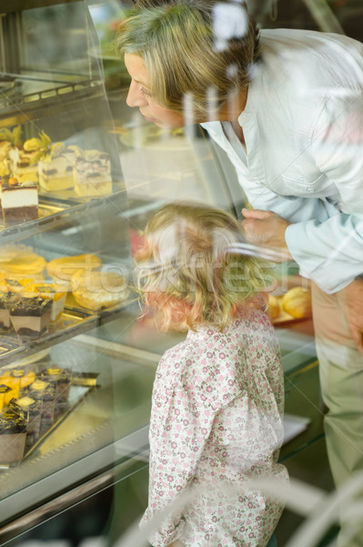 Grandchild and grandmother looking at cakes cafe Stock photo © CandyboxPhoto