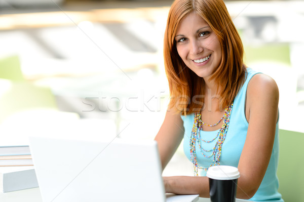 Smiling student girl with laptop at college Stock photo © CandyboxPhoto