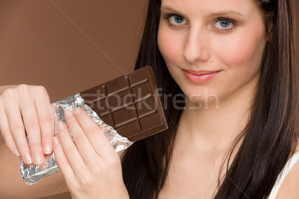 Chocolate retrato mulher jovem morder doces Foto stock © CandyboxPhoto