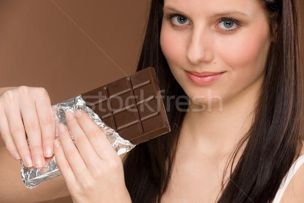 Csokoládé portré fiatal nő falat édesség el Stock fotó © CandyboxPhoto