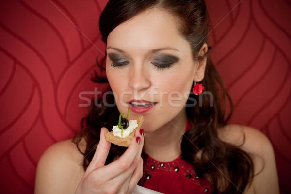 Cocktail party vrouw eten voorgerechten avondkleding Rood Stockfoto © CandyboxPhoto