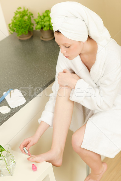 Young student girl polishing her toe nails Stock photo © CandyboxPhoto