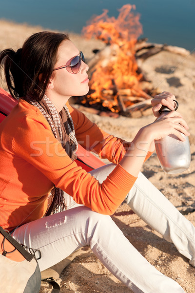 Camping happy woman by campfire on beach  Stock photo © CandyboxPhoto