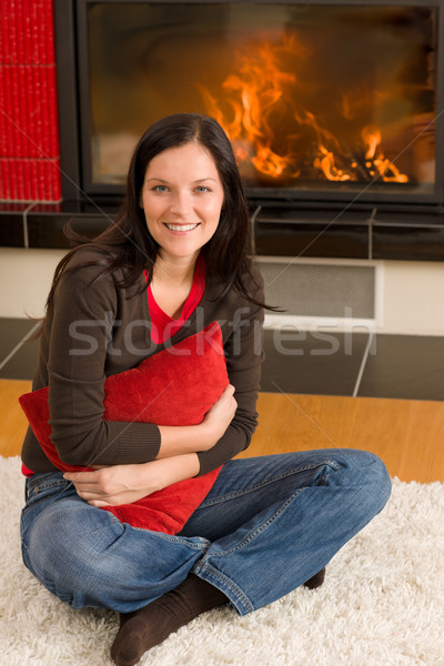 Home fireplace happy woman hold cushion Stock photo © CandyboxPhoto