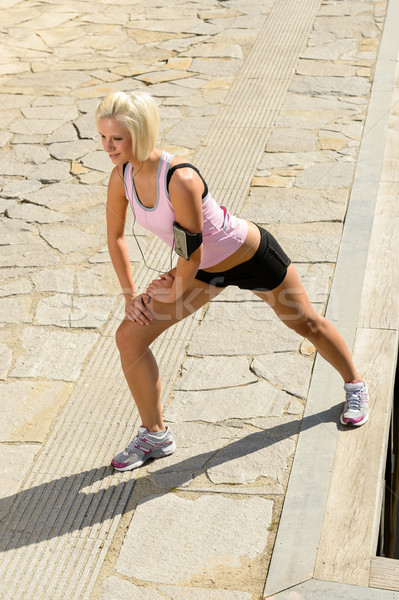 Fit woman stretch body sunny day Stock photo © CandyboxPhoto