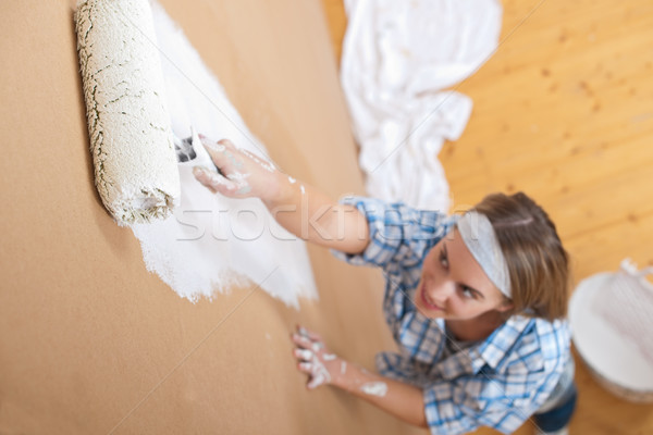 Home improvement: Young woman painting wall Stock photo © CandyboxPhoto
