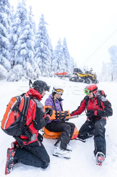 Ski patrol team rescue woman broken arm Stock photo © CandyboxPhoto
