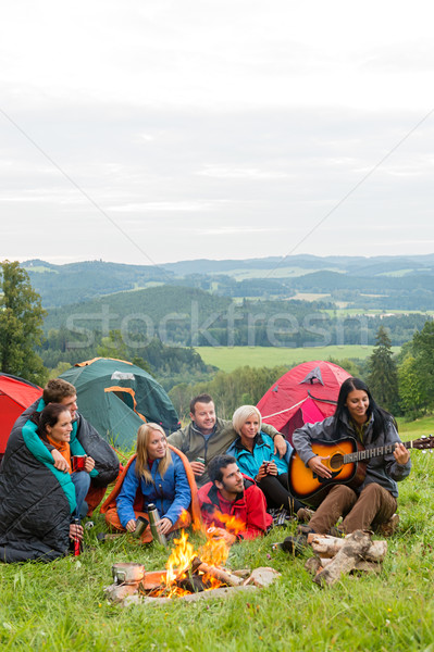 Camping friends playing guitar beside fire nature Stock photo © CandyboxPhoto