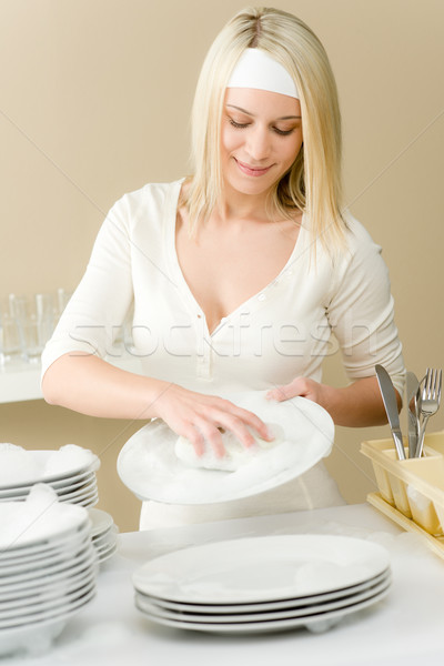 Modern kitchen - happy woman washing dishes Stock photo © CandyboxPhoto