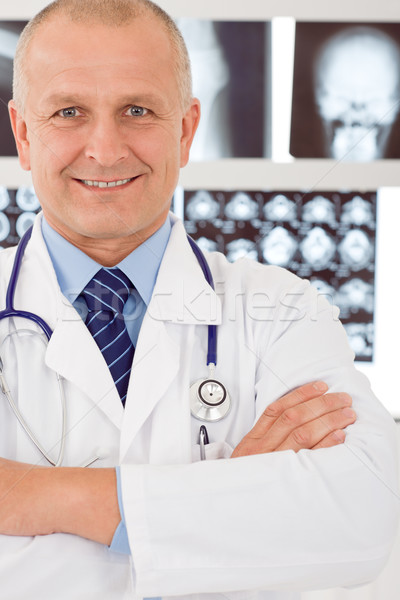 Stock photo: Mature doctor male with set of x-ray