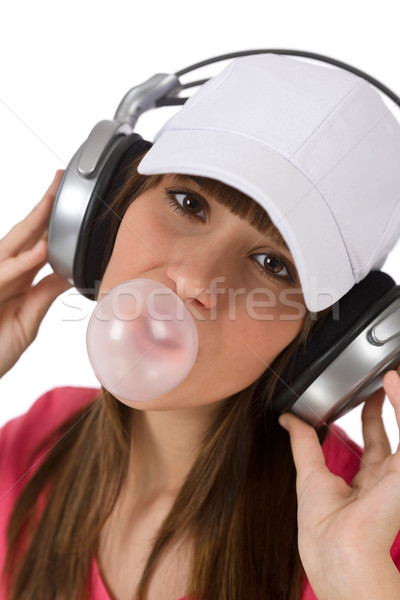 Female teenager with bubble gum and headphones Stock photo © CandyboxPhoto