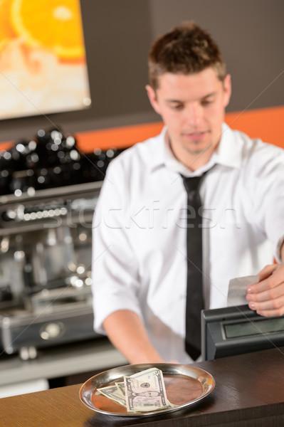 Jóvenes barman uniforme toma efectivo dólar Foto stock © CandyboxPhoto