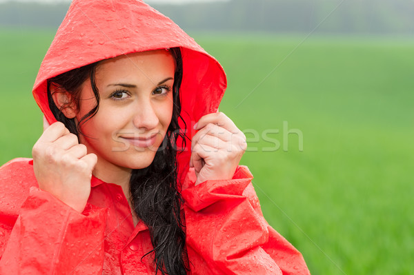Adolescent girl in the rain in cloak Stock photo © CandyboxPhoto