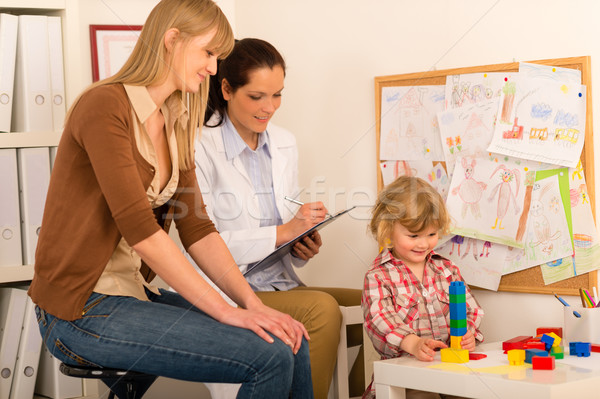 Pediatrician observe child girl play at surgery Stock photo © CandyboxPhoto