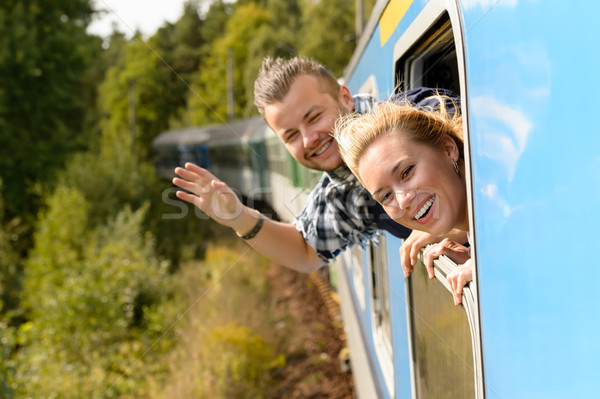 Couple waving with heads out train window  Stock photo © CandyboxPhoto