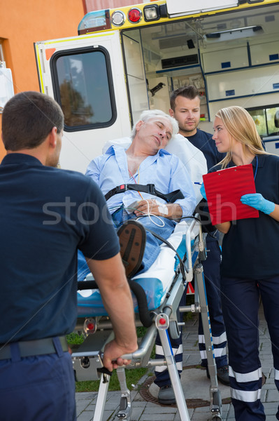 Paramedical team helping injured man on stretcher Stock photo © CandyboxPhoto