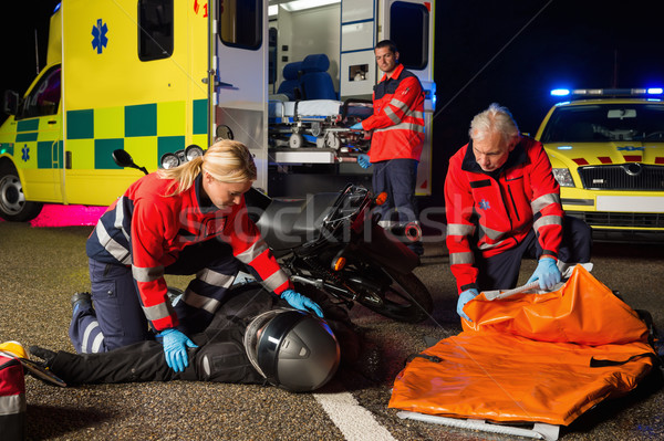 Emergency team assisting injured motorbike driver Stock photo © CandyboxPhoto