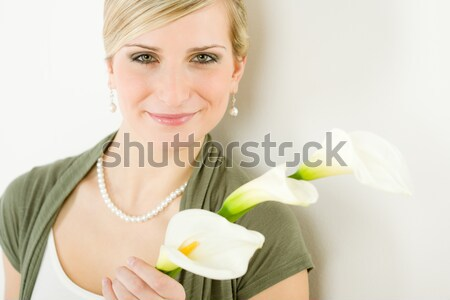 Portrait of calla lily flower woman in background Stock photo © CandyboxPhoto