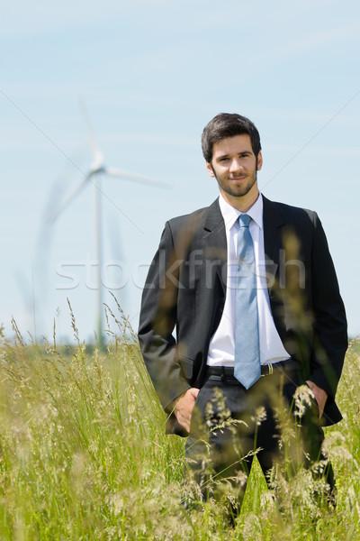 Groene energie jonge zakenman veld windmolen man Stockfoto © CandyboxPhoto
