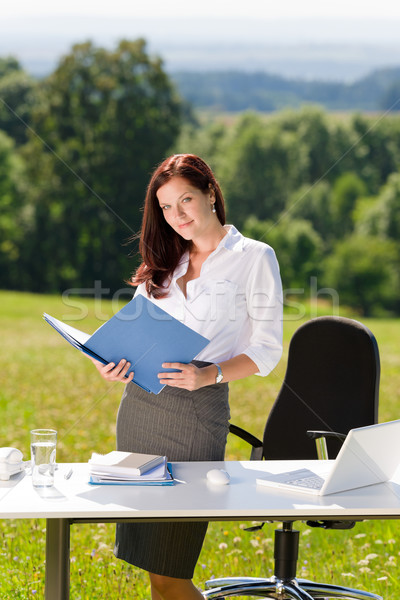 Businesswoman in sunny nature office look folder Stock photo © CandyboxPhoto