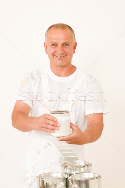 Stock photo: Home decorating mature male painter mix color