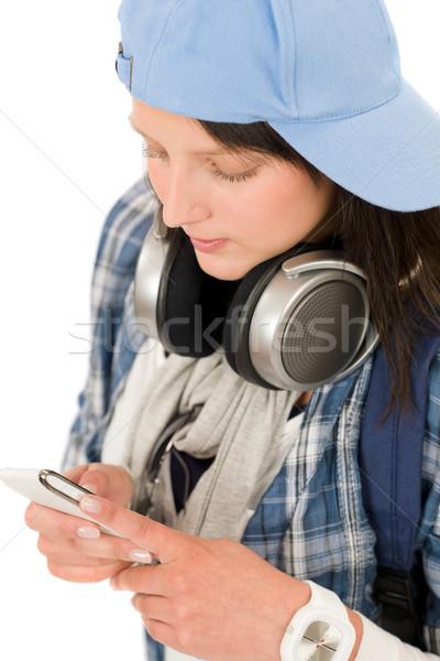Smiling teenager girl enjoy music with headphones Stock photo © CandyboxPhoto