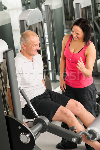Fitness center active man exercising with trainer Stock photo © CandyboxPhoto