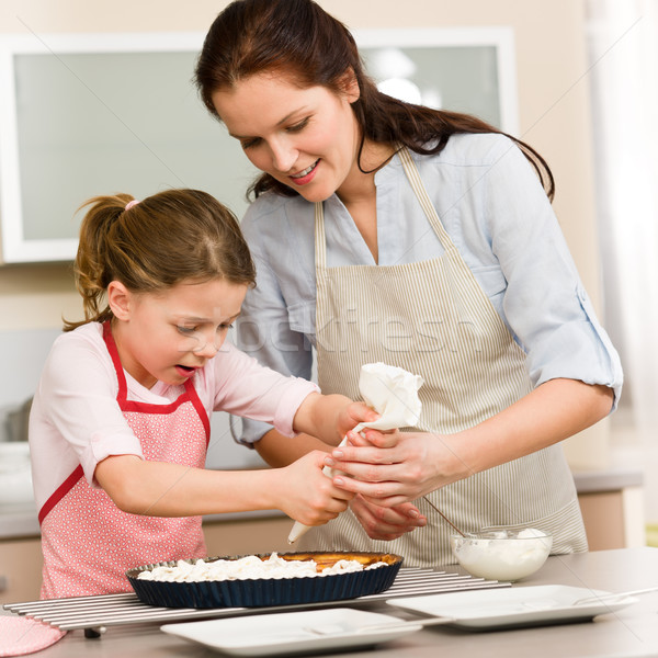Decorating cake mother and daughter Stock photo © CandyboxPhoto