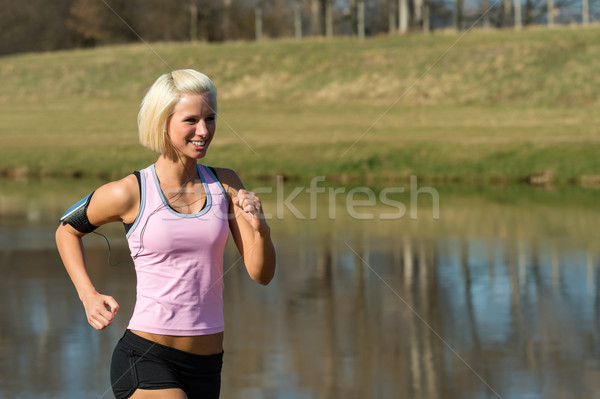 Young woman jogging lake park sunny day Stock photo © CandyboxPhoto