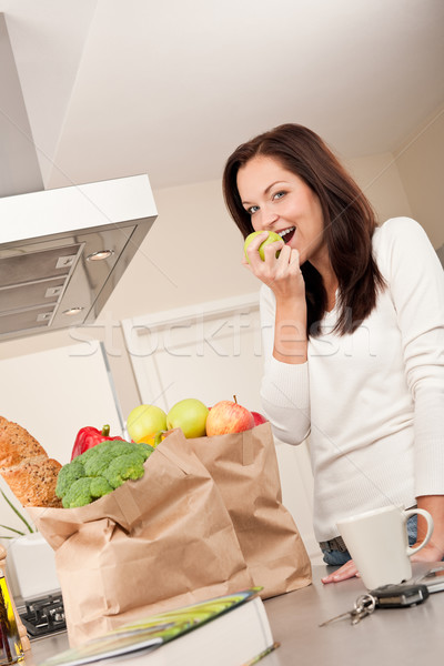 Young smiling woman with groceries in the kitchen  Stock photo © CandyboxPhoto