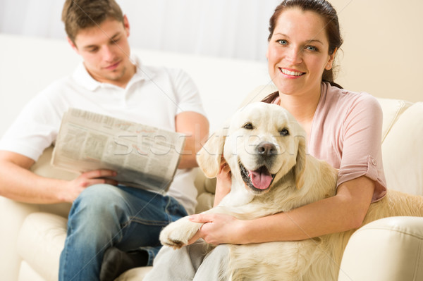 Resting joyful couple sitting and petting dog Stock photo © CandyboxPhoto