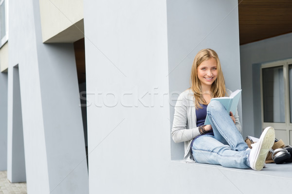 Teenage woman reading book outside of school Stock photo © CandyboxPhoto