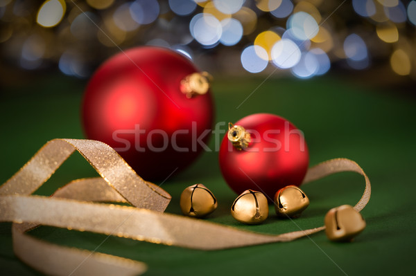 Red Christmas baubles & gold jingle bell Stock photo © CandyboxPhoto